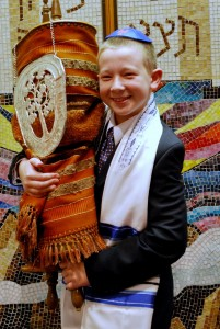 Guest of honor with the Torah at Bar Mitzvah