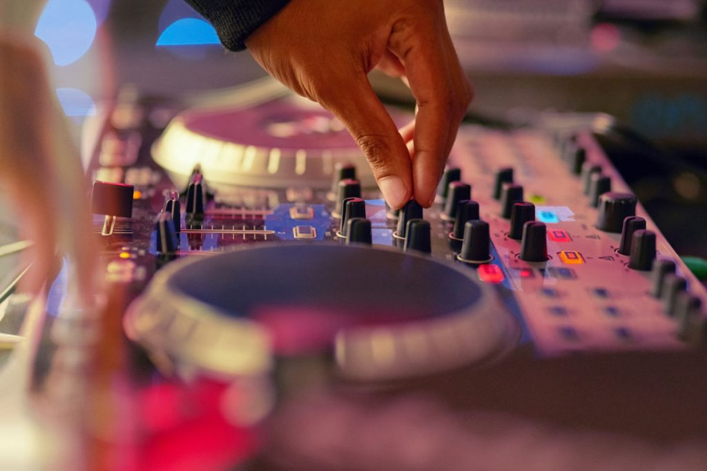 Professional DJ vs. Friend with a Playlist: What's the Right Choice for Your Wedding?